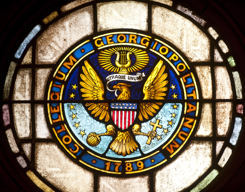 close-up of stained glass window of Georgetown University Seal