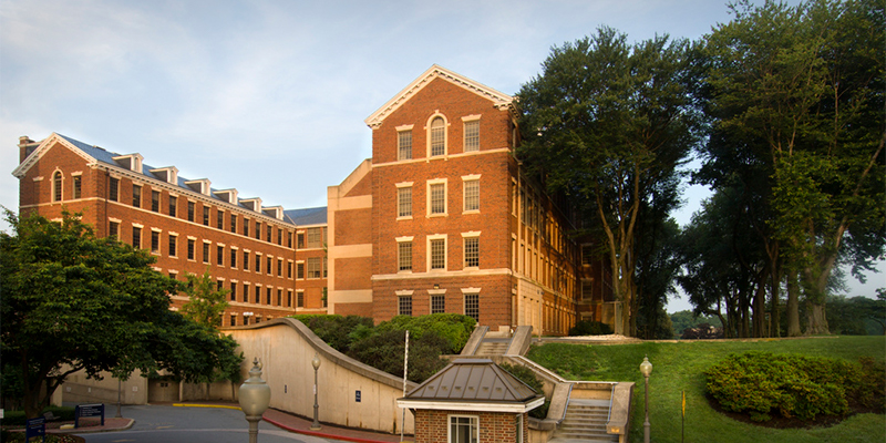 A side view of the Med-Dent building at sunset