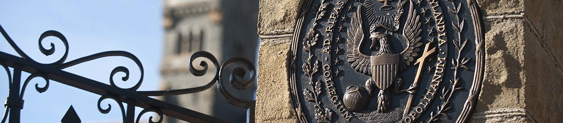 closeup of Georgetown seal at University's front gate
