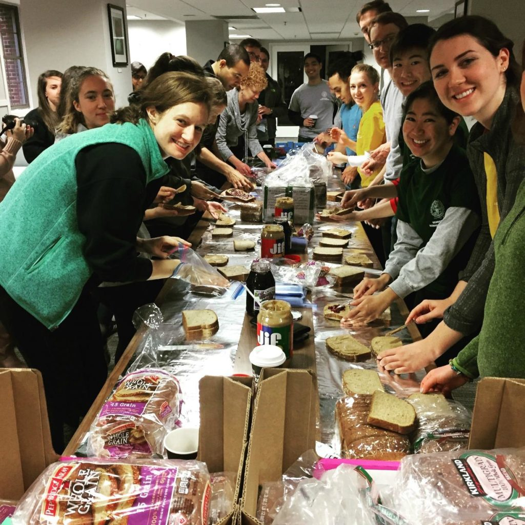 Students making sandwiches. From GUSOM Day of Service, 2016