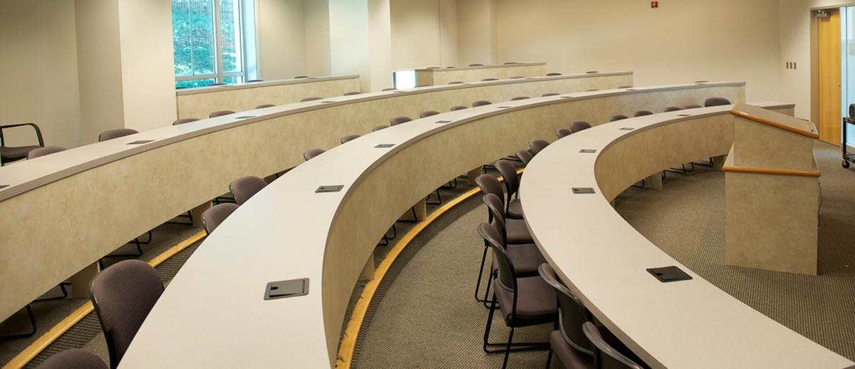 desks in a theater-style classroom