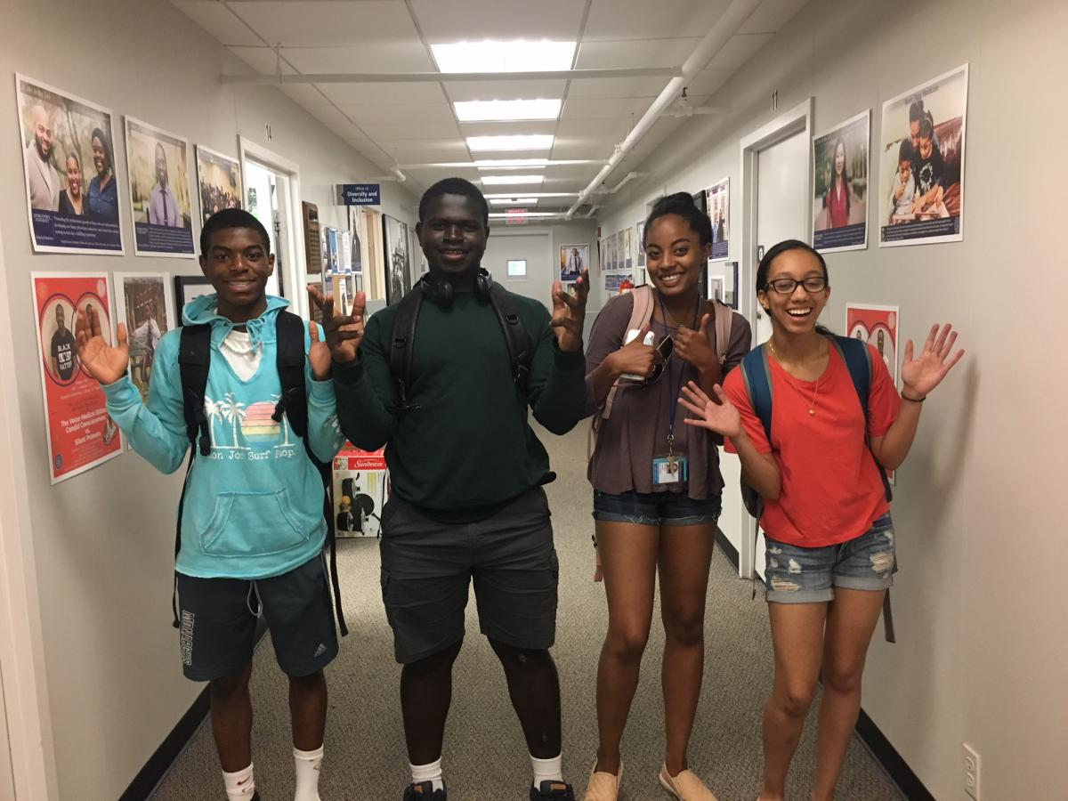 Picture of 4 Students, 2 black males and 2 black females in the hallway of the Office of Diversity and Inclusion