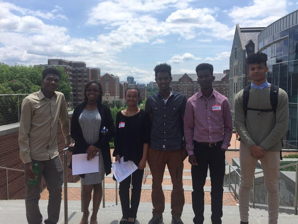 GEP picture of scholars on a scavenger hunt around GUSOM campus