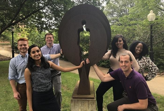 Students with statue