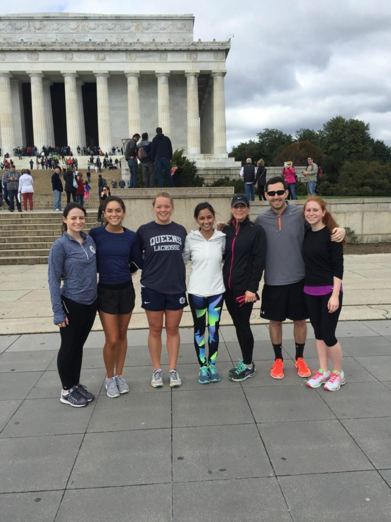 photo of 7 students from a Knowlan event, standing in front of the Lincoln Memorial, Washington DC