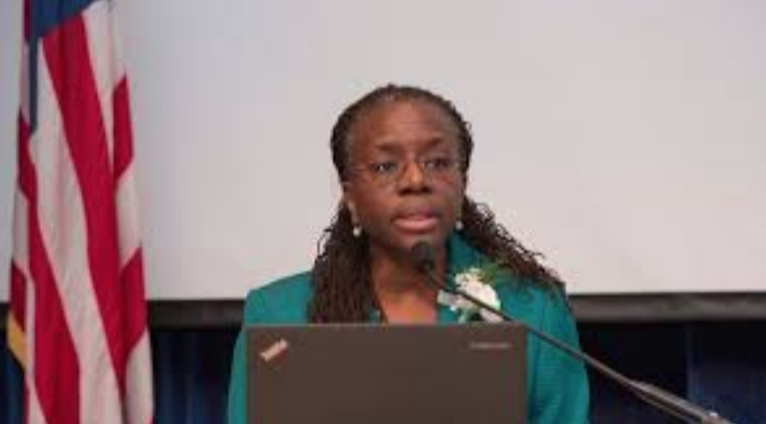 Picture of Dr. Yearwood speaking at a podium