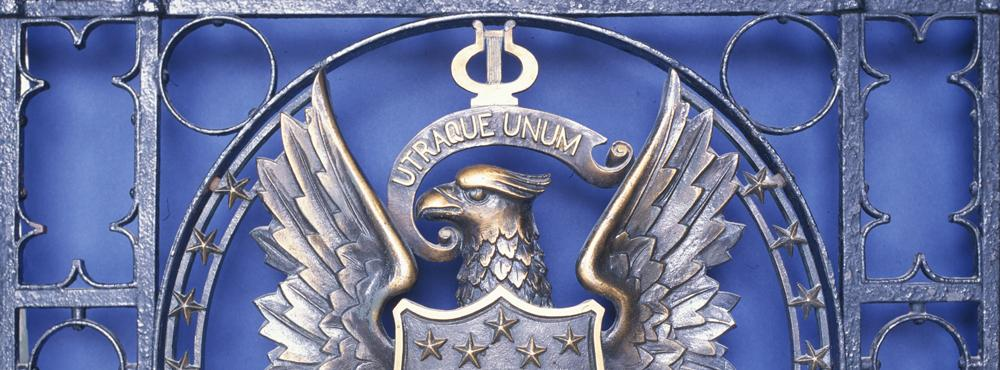 Georgetown University seal in metal relief against a blue backdrop