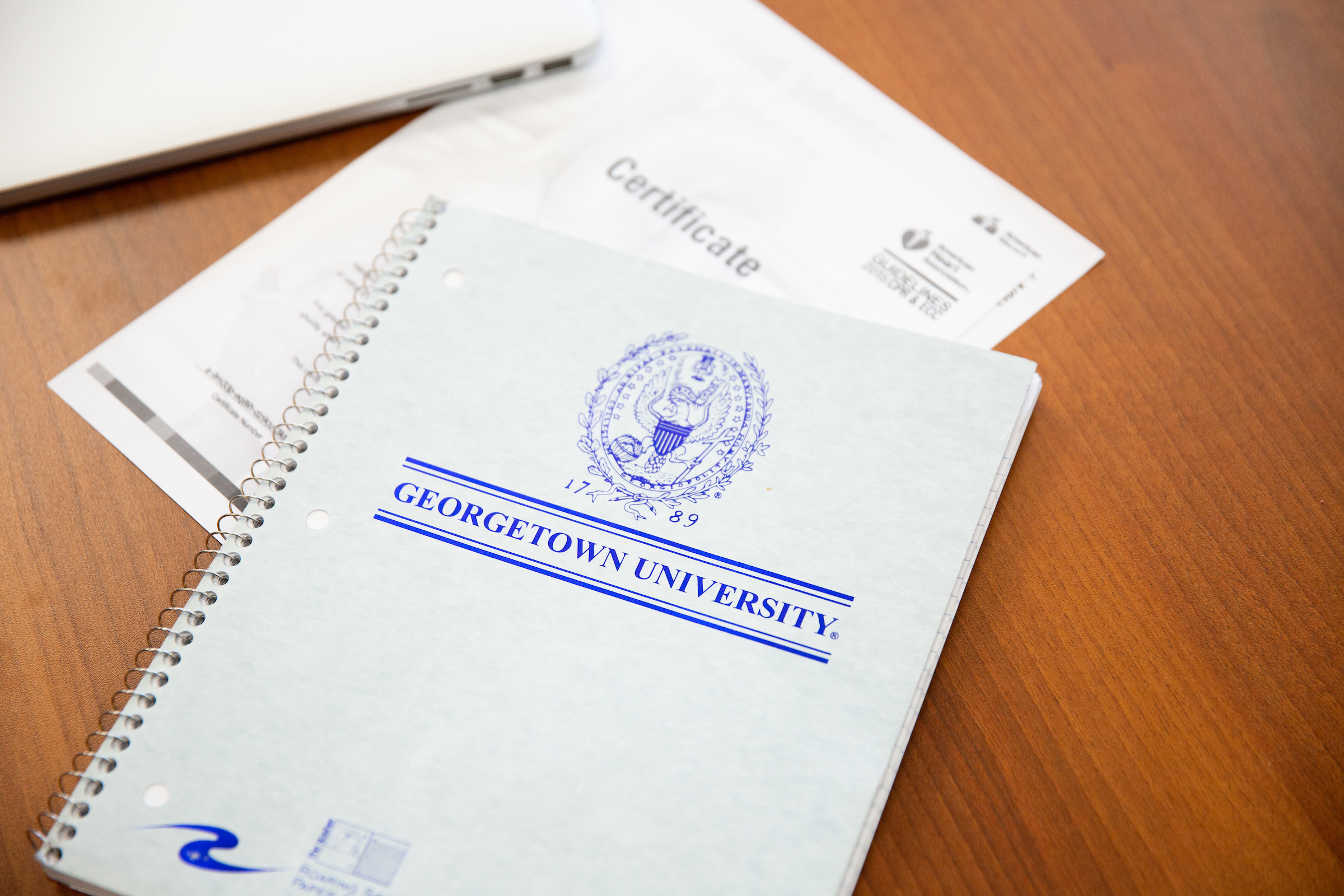 Spiral notebook with Georgetown University Seal on cover