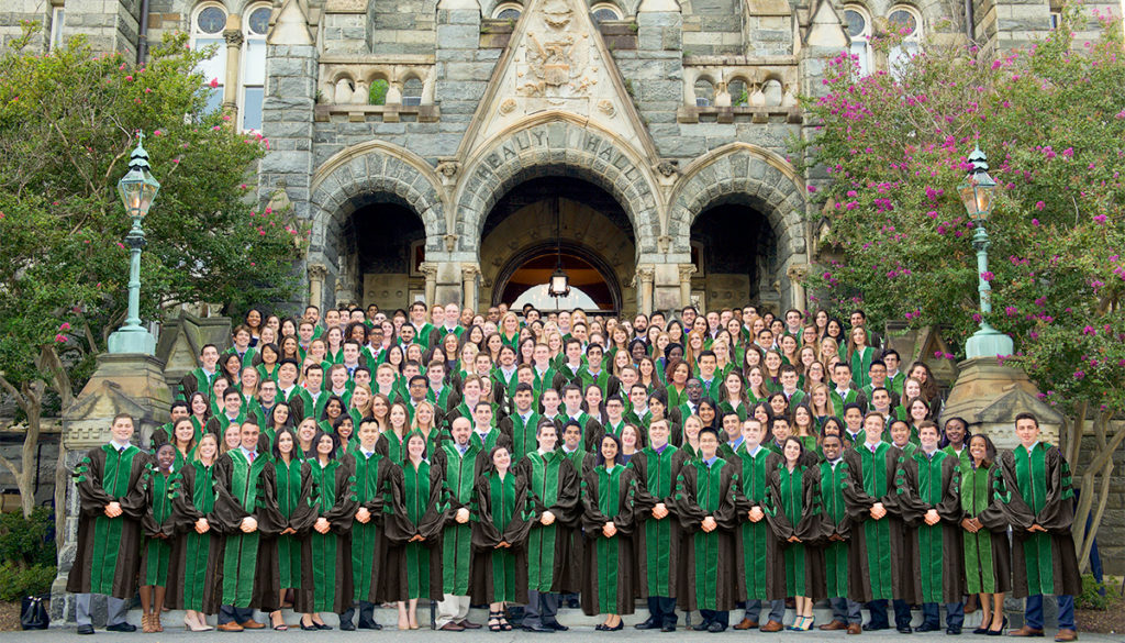 A photocollage of images of students in their academic regalia on the steps of Healy Hall