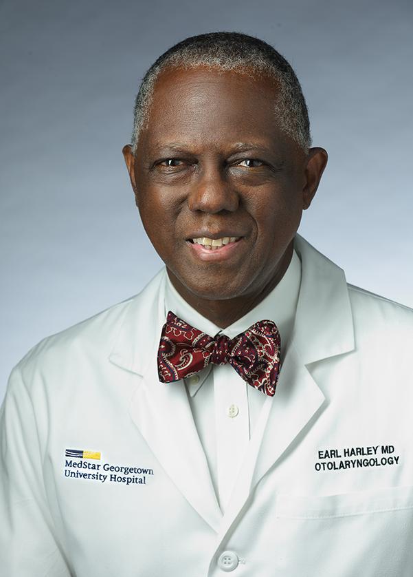 Dr. Earl Harley in white coat